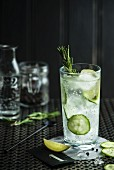 A cocktail with cucumber and rosemary