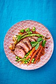 Lamb fillet with carrots and peas