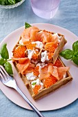 Waffles with salmon, caviar and crème fraîche