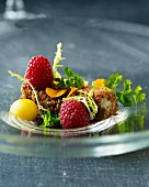 Breaded cod fillet with raspberries, parsley and egg yolk