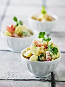 Potato salad with chickpeas, tomatoes and parsley