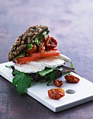 A wholemeal roll with mozzarella, rocket, tomatoes and avocado