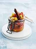 Tomato, onion, apple and cinnamon chutney in a flip-top jar