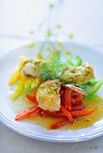 Monk fish with a fennel sauce on a pepper medley