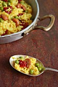Saffron rice with peas, dried tomatoes and cashew nuts