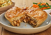 Chicken pie with potatoes and vegetables