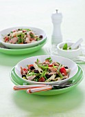 Pasta salad with pesto dressing, tuna fish, cherry tomatoes and olives