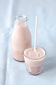 A banana and cherry smoothie made with soya milk