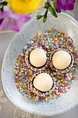 Marzipan eggs with chocolate glaze and sugar sprinkles for Easter