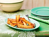 Honey roasted parsnips on green ceramic plate
