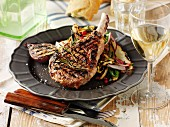 Grilled pork chops with vegetables and white wine