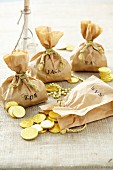 Homemade sacks of chocolate coins for a pirate party