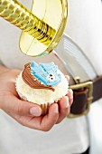 A cupcake with a marzipan pirate decoration
