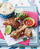 Spicy-coated chicken legs with coleslaw