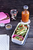 Courgette pasta and a dip in a lunchbox