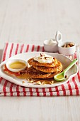 Butternut pancakes with maple syrup and nuts