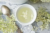 Elderflower tea in a white tea bowl