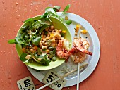 Prawn skewers with a chickpea and mango salad