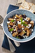 Aubergine and feta cheese salad with pine nuts