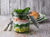 Layered kohlrabi and crayfish cocktail in a jar