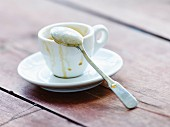 An empty espresso cup with a spoon