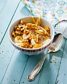 Fresh seed muesli with apples, bananas and walnuts