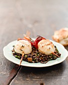 Scallop skewers with beluga lentils