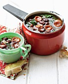 Chorizo and kidney bean soup with spinach