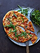 Pizza with scamorza and rocket