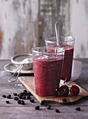 An aronia berry and cherry smoothie with gooseberries, cocoa and flaxseeds