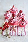 Cupcakes with raspberries and white chocolate
