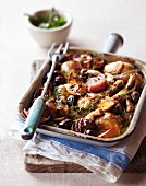 Oven-baked chicken with red onions and olives