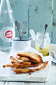 Breaded chicken escalopes on a piece of kitchen paper