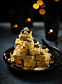 Burfi (Indian vanilla sweets) with golden blueberries
