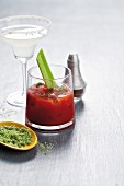 A Margarita with a lime-salt rim and a Bloody Mary with a stalk of celery