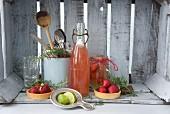 A strawberry tartlet, elderflower jelly with sliced strawberries and strawberry juice with a lime