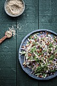 Cabbage and fennel salad with almonds, sesame seeds and fennel leaves