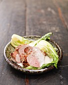 Pork fillets with a ginger and coconut sauce on a bed of bok choy
