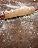 A wooden rolling pin dusted with flour