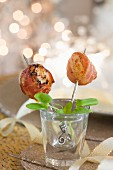 Scallops wrapped in Serrano ham on sticks for Christmas
