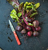 Beetroot with leaves and a knife