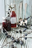 Pickled sloes and sloe syrup with apples
