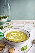 Spinach and pea soup with croutons