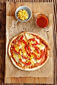 Pizza Hawaii with ham, pineapple, pepper and sweetcorn