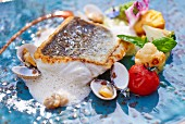Hake with clams and vegetables
