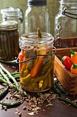 Asparagus and peppers with pickling spices in a vintage preserving jar
