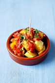 Patatas bravas (potatoes with spicy tomato salsa, Spain)