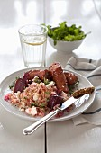 Smoked sausages with bulgur, feta cheese and beetroot