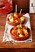 Patatas bravas (baked potatoes with tomato salsa, Spain)