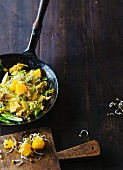 Oriental scrambled eggs with and orange and bean sprout salad (Paleo)